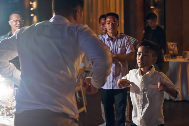 Fun game at wedding reception Groom playing drinking game chinese wedding dinner stock pictures, royalty-free photos & images