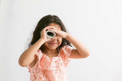 Fun Girl Looking At View Handheld Telescope Stock Photo - Download Image Now