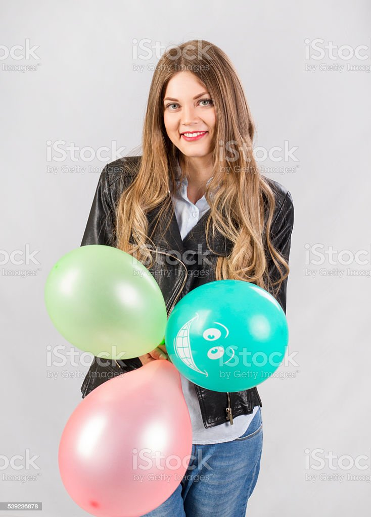 fun girl model in studio with balloons royalty-free stock photo