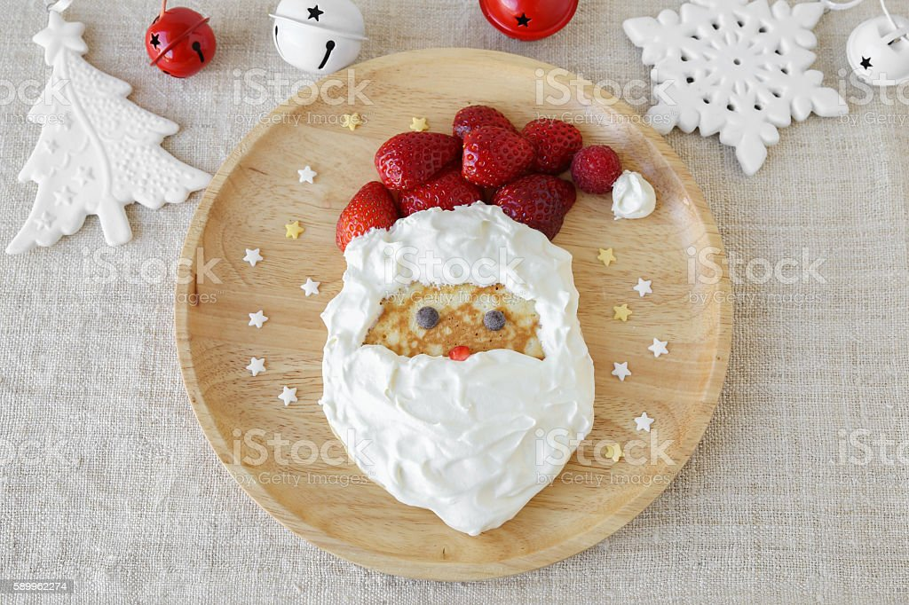 Fun homemade santa pancake breakfast for kids stock photo