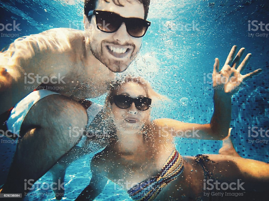 Fun in a swimming pool. stock photo
