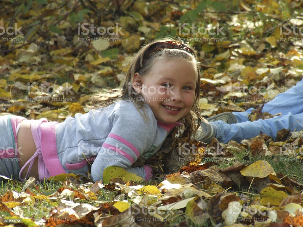 Fun in the Fall Leaves royalty-free stock photo