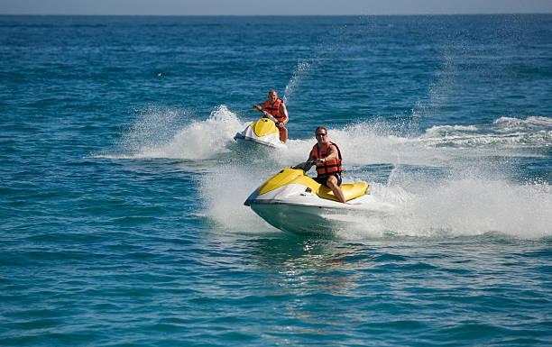 Fun in the ocean on waverunners. stock photo