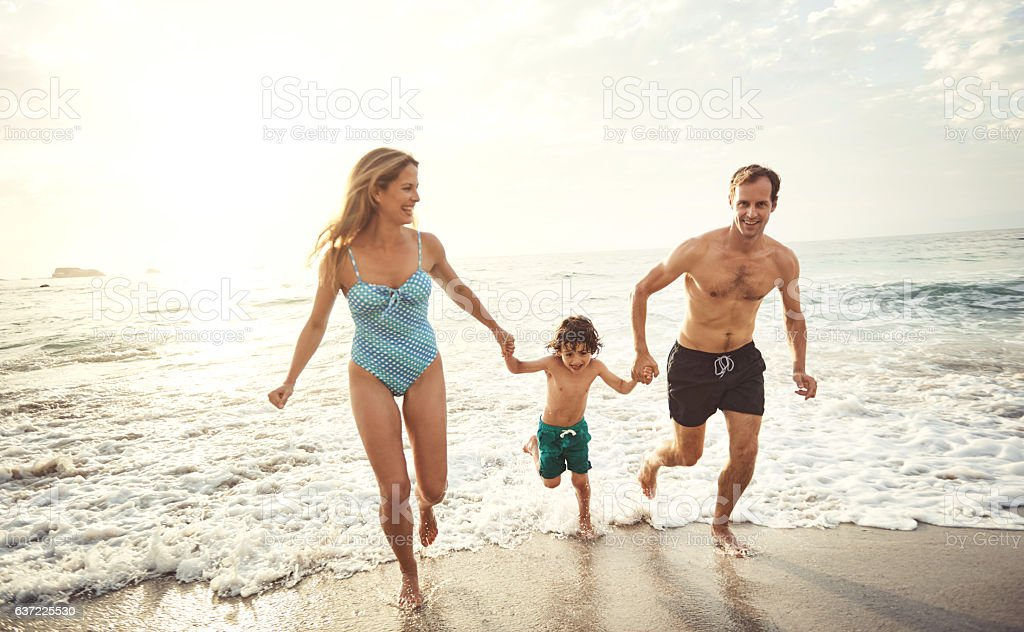 Fun is always better at the beach! stock photo