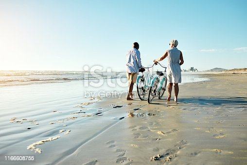Shot of a senior couple riding their bicycles at the beach