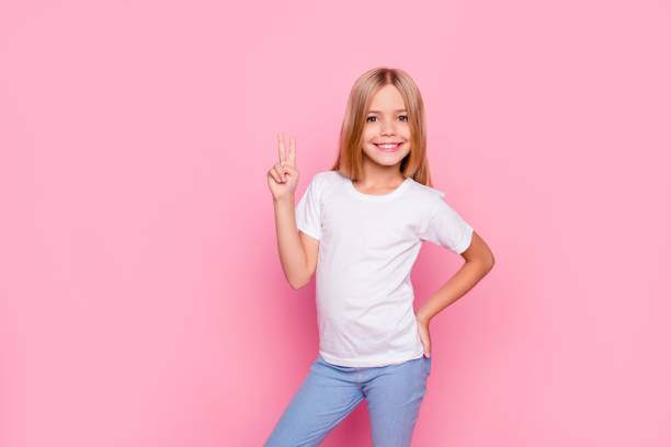 fun joy enjoy people person funtime concept. portrait of cute lovely carefree confident sweet adorable beautiful girl in casual modern outfit demonstrating v-sign isolated on pink background - take care of your jeans imagens e fotografias de stock