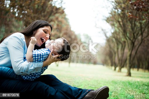 811227514 istock photo Fun latin mother holding little boy and laughing 691670076