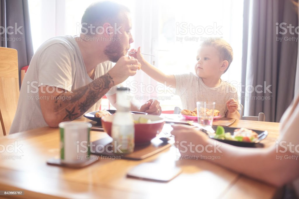 Fun meal time with mummy and daddy stock photo