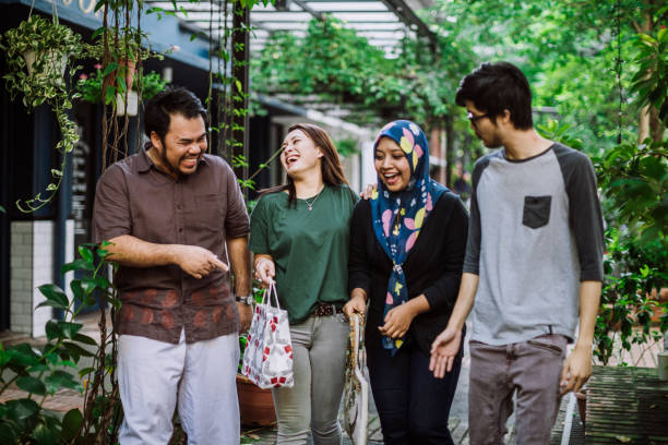 Fun On Double Date Young Couples Joking And Laughing While Laughing In City Walk indonesian ethnicity stock pictures, royalty-free photos & images