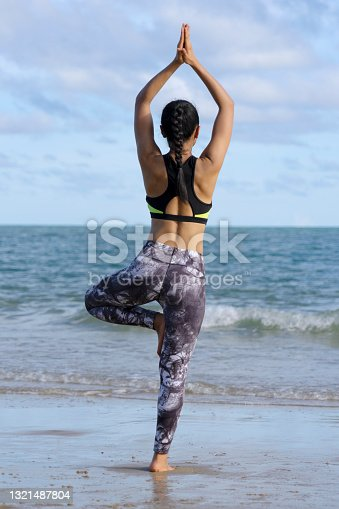 Man and woman exercise together at the beach. Summer time and sunshine. Summer and the beach concept.