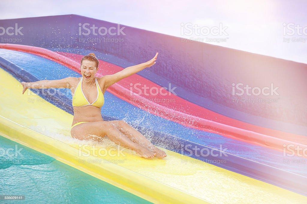 fun on water slide stock photo