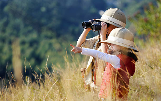 fun outdoor children playing - safari stock photos and pictures