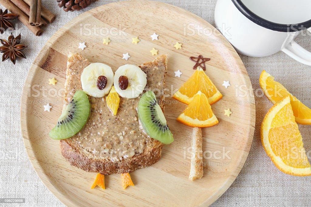 Fun owl toast with fruit, food art breakfast for kids stock photo