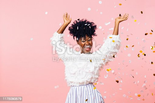 Fun party girl, smiling woman throwing confetti