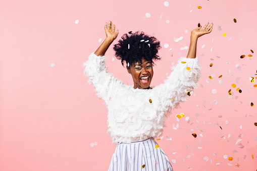 Fun Party Girl Smiling Woman Throwing Confetti Stock Photo - Download Image Now