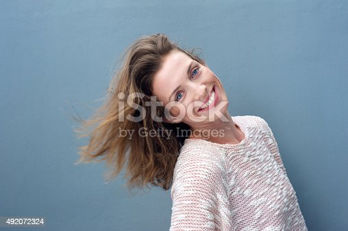 istock Fun portrait of an excited beautiful woman smiling 492072324