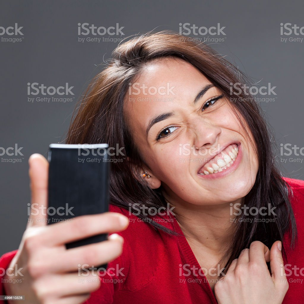 Fun Selfie With Toothy Smile From Cute Young Multiethnic Girl Stock Photo
