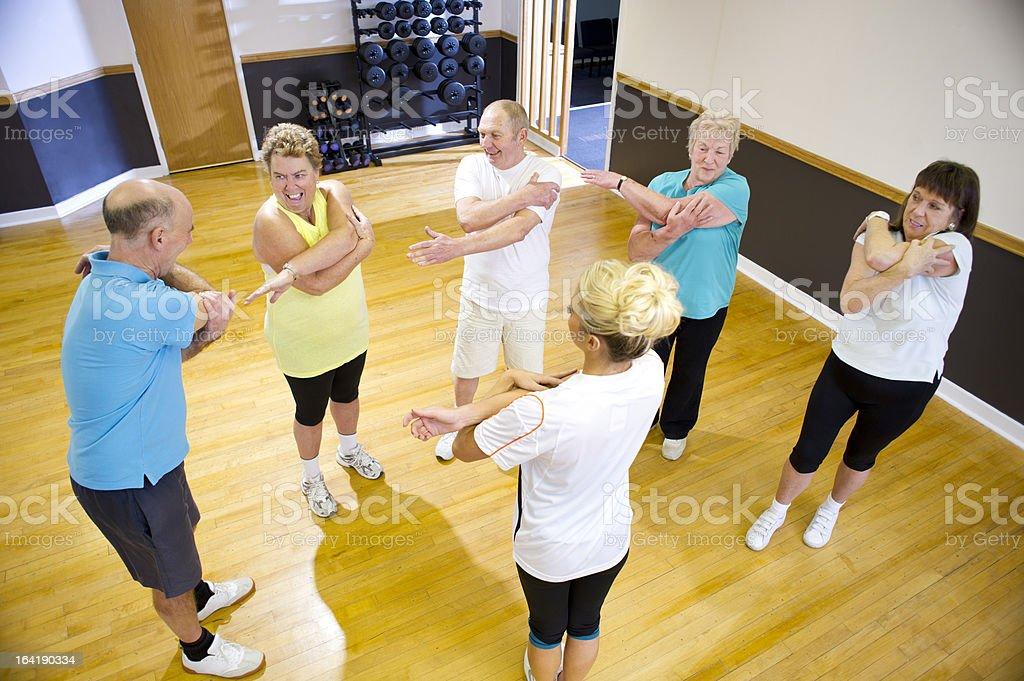 fun senior gym stretching royalty-free stock photo