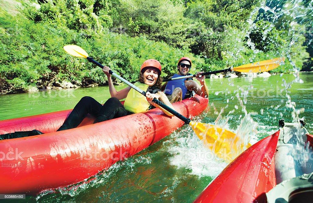 fun splashing canoe river stock photo