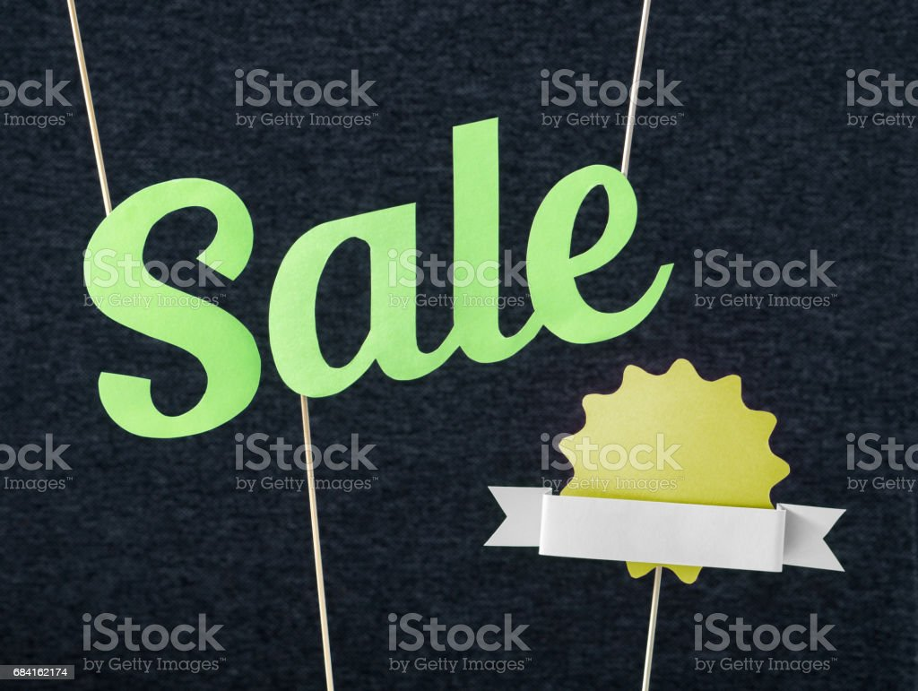 Fun summer sale design for promo. Hanging green letters and yellow badge with ribbon cut from cardboard paper on wooden stick. Fresh and fun marketing look. Free blank empty copy space for text. zbiór zdjęć royalty-free
