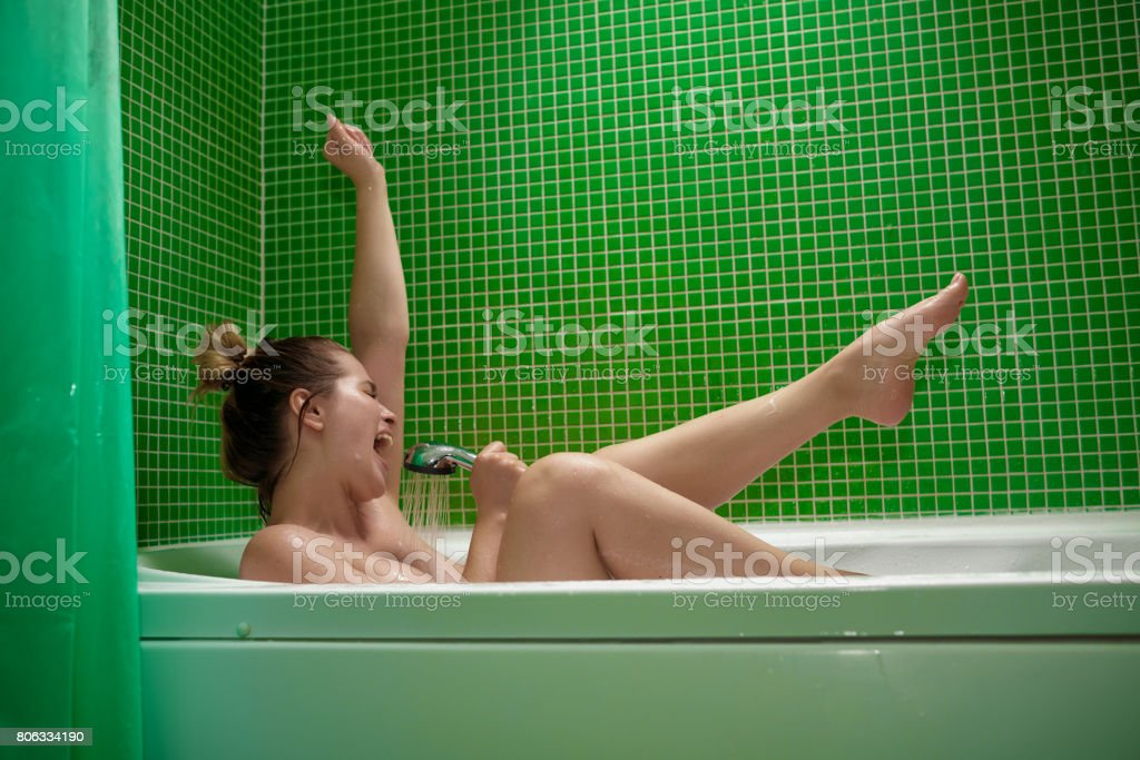 fun time and music in the bathtub stock photo