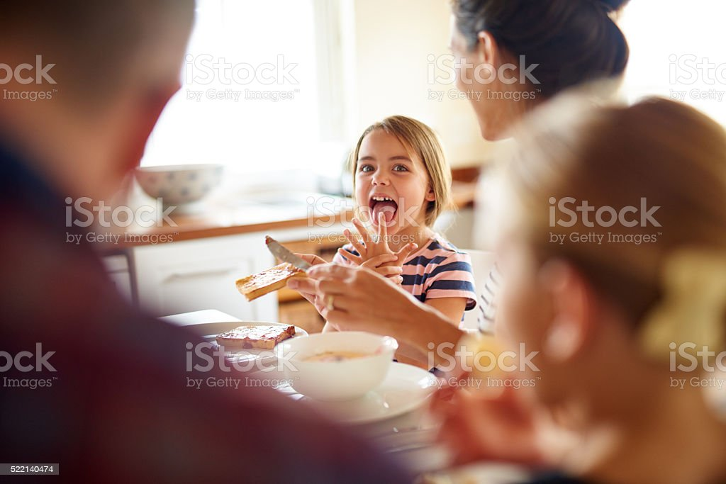 Fun times at the breakfast table stock photo