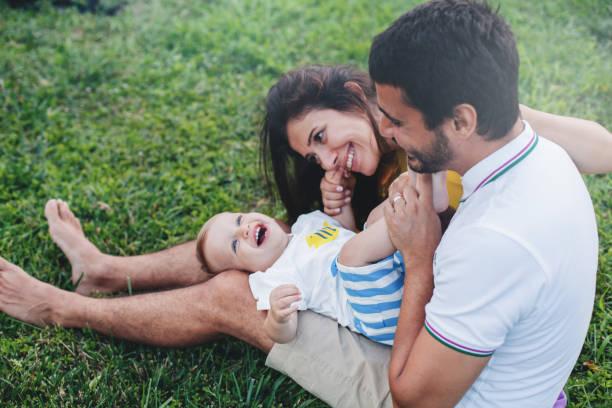 plezier met babyjongen - turkse etniciteit stockfoto's en -beelden