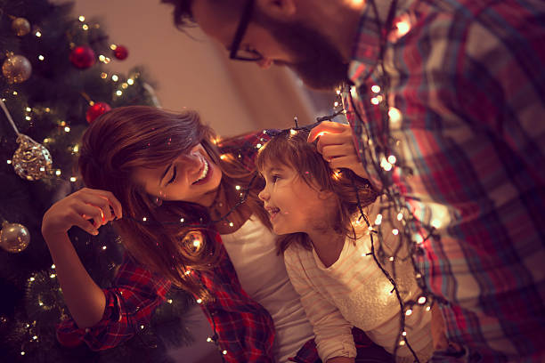fun with christmas lights - christmas stock photos and pictures