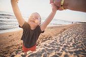 Fun with son on the beach