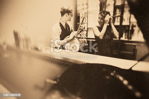 istock Fun with the banjo player in the bar!!! 1067466938