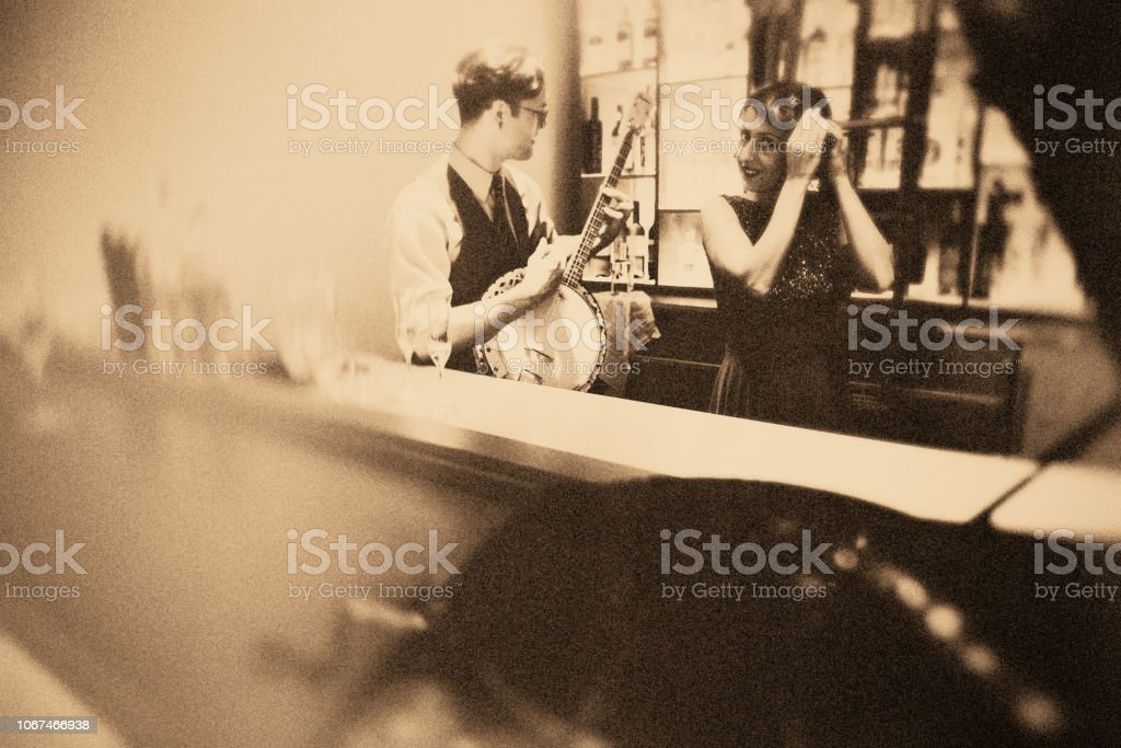 Fun with the banjo player in the bar!!! stock photo
