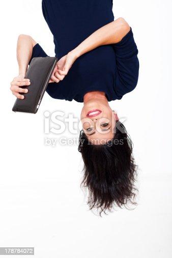istock fun woman using tablet computer upside down 178784072
