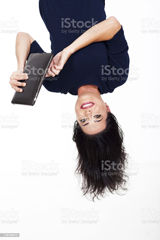 fun woman using tablet computer upside down stock photo