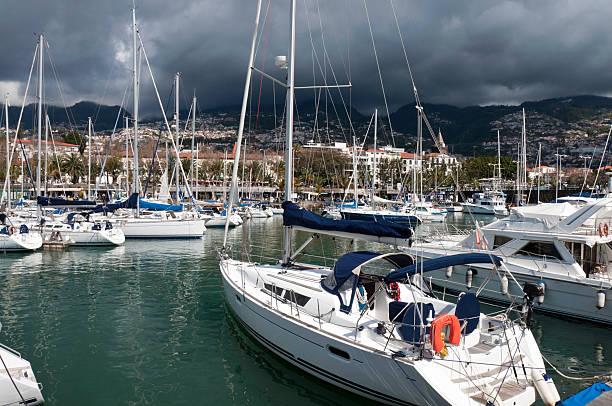 funchal marina - rain clouds porto portugal imagens e fotografias de stock