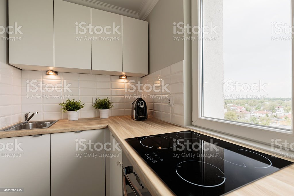 Functional kitchen in new flat stock photo