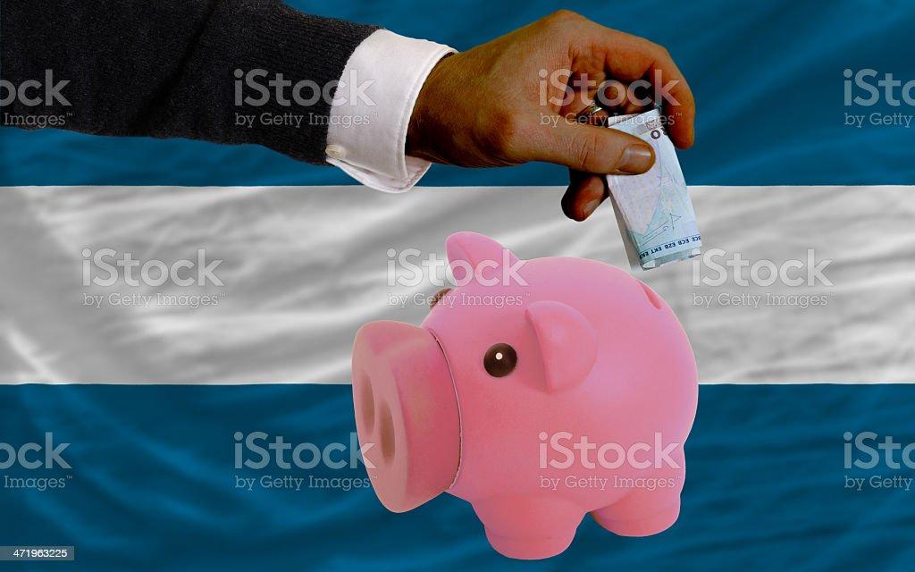 Funding euro into piggy rich bank flag of el salvador stock photo