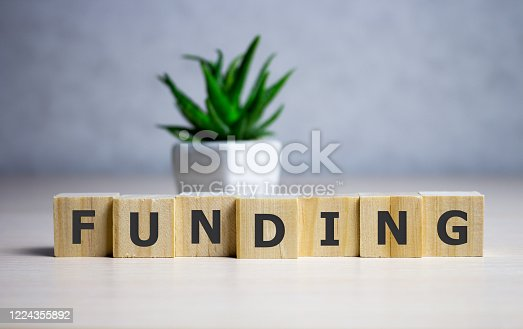 Funding Word Written In Wooden Cube, business concept