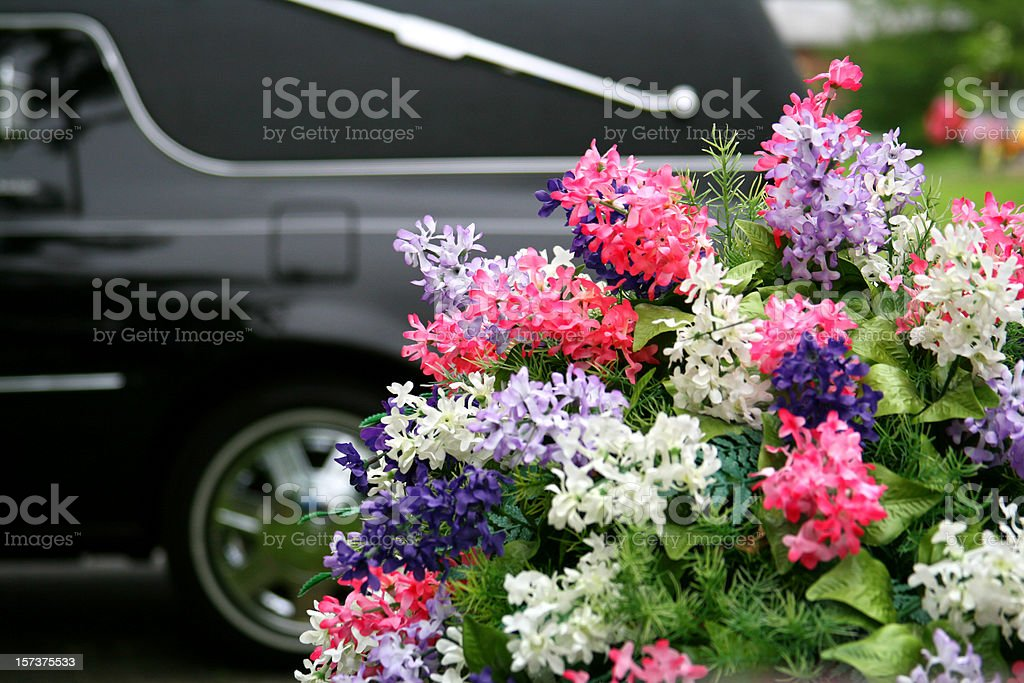 Funeral Concepts: Hearse and Flowers stock photo
