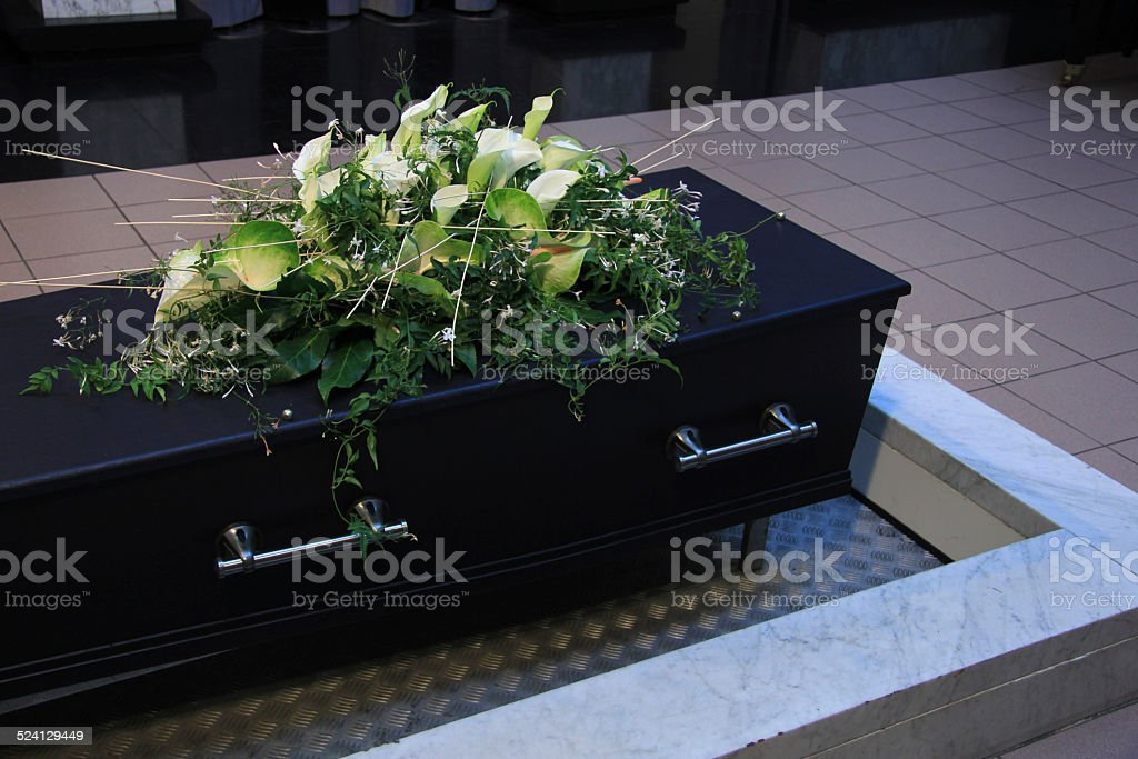 Funeral flowers on a casket stock photo