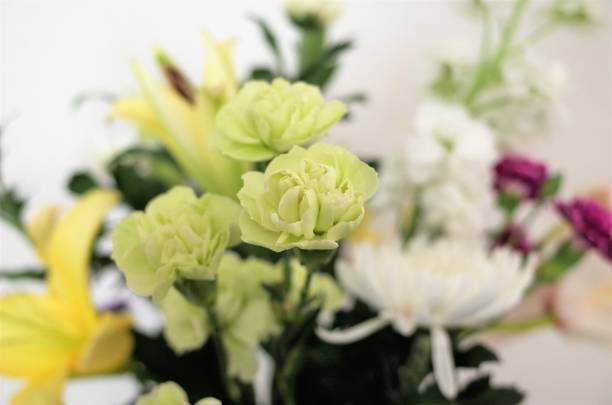 Funeral flowers, statice, lilies, Turkey china, chrysanthemums and stocks stock photo