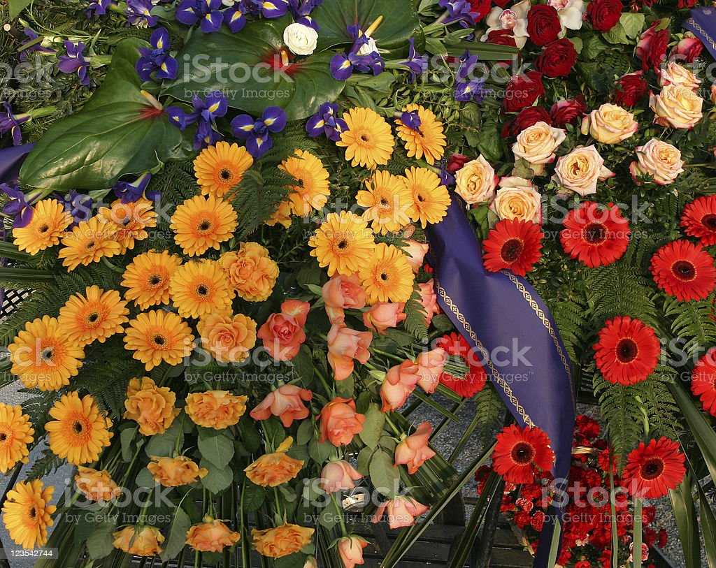 Funeral flowers with banner stock photo more pictures of funeral flowers with banner royalty free stock photo izmirmasajfo
