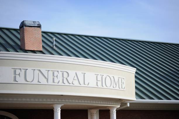 Funeral home sign on building stock photo