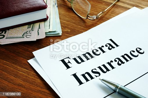 Funeral insurance agreement, money and glasses.