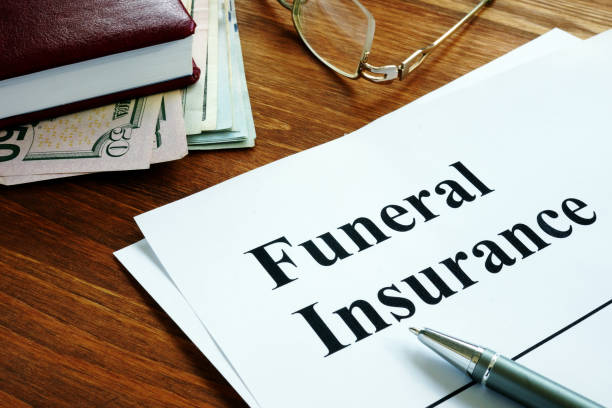 Funeral insurance agreement, money and glasses. stock photo