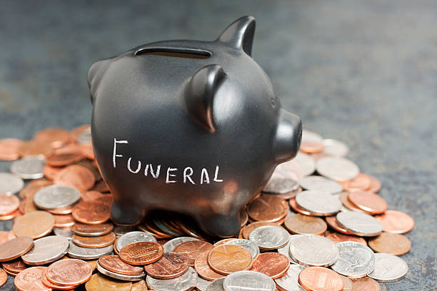"""Funeral"" Piggy Bank on Coins stock photo"
