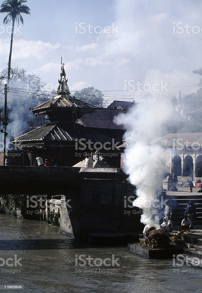 Funeral pyres on the riverbank in Kathmandu royalty-free stock photo