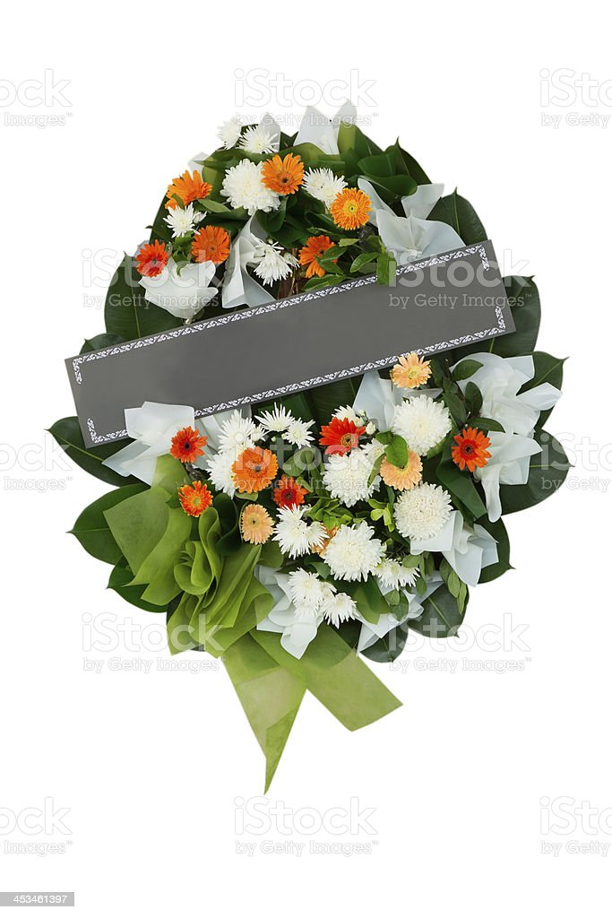 Funeral wreath with orange and white flowers and a green bow stock photo