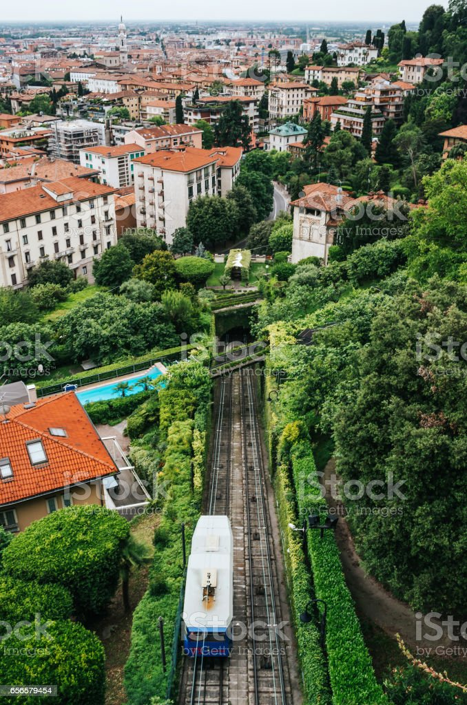Funicular Citta Alta in Bergamo. Scenic view from old city. Beautiful vertical travel postcard. stock photo
