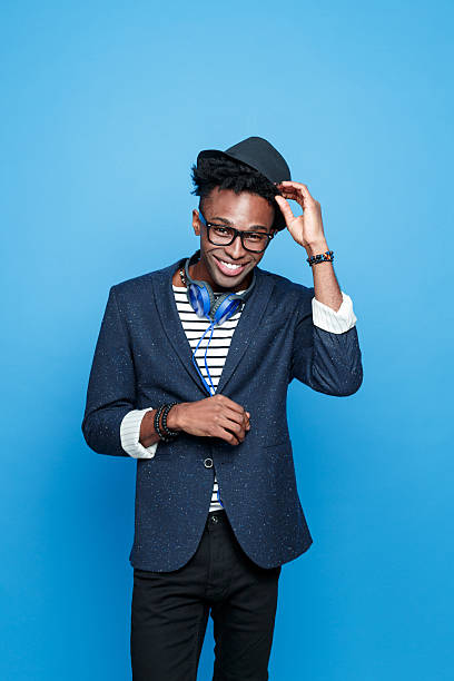funky afro american guy in fashionable outfit - preppy fashion stock photos and pictures