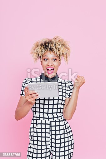 538883870istockphoto Funky afro american woman using a digital tablet 538882766